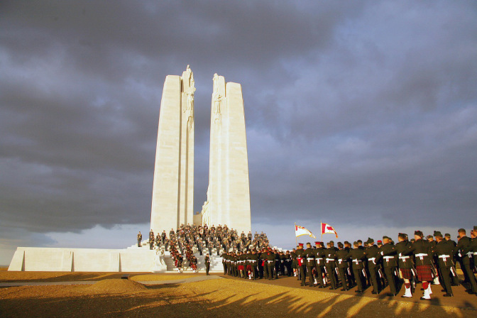 Vimy, FRANCE: Canadian soldiers parade in front of the Canadian memorial, 07 April 2007 in Vimy (northern France), to commemorate the 90th anniversary of the battle of Vimy Ridge, a painful World War I victory that firmed Canada's national identity. Almost 7.000 Canadians will travel to northern France on 09 April to commemorate the anniversary, that will be led by Canadian Prime minister Stephen Harper and his family, who will honor the memory of Canadian soldiers killed during the battle. A total 3,598 Canadian Corps troops were killed and 7,004 were wounded over four days of fighting as they seized control of the ridge from German soldiers.   AFP PHOTO PHILIPPE HUGUEN (Photo credit should read PHILIPPE HUGUEN/AFP/Getty Images)